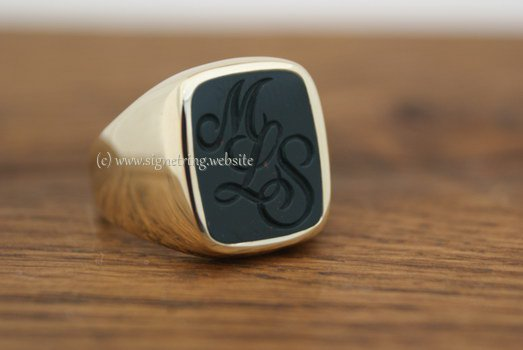 Gold ring with gemstone and engraving