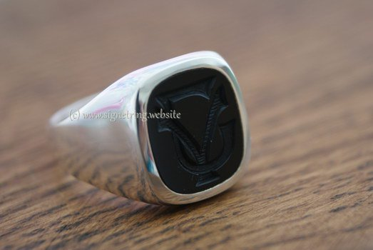 Silver ring with onyx engraving