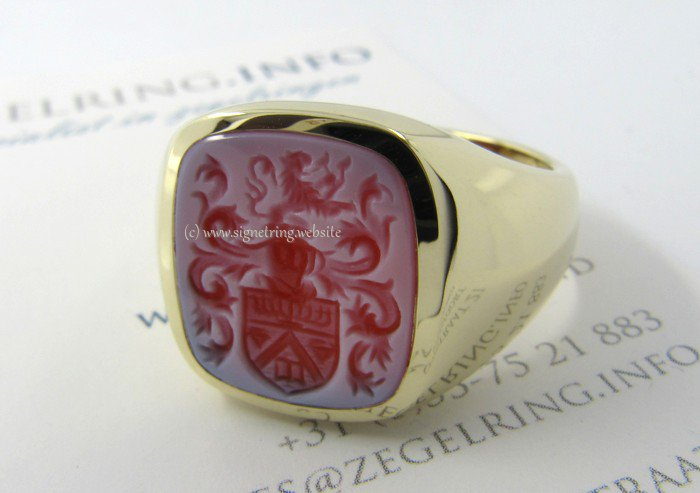 Mens signet ring with red layered agate