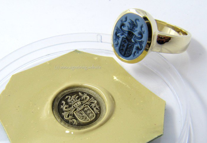 Signet ring with light blue layered agate
