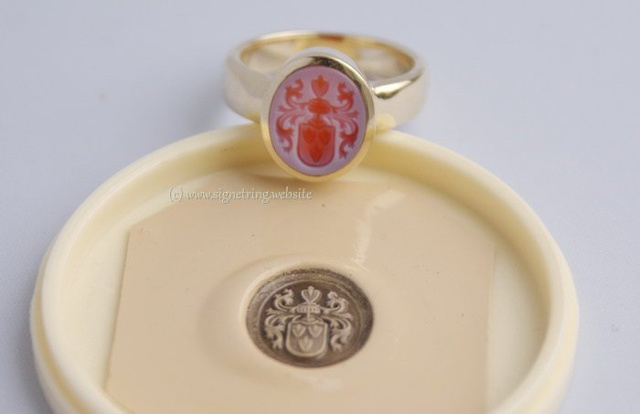 Signet ring with red layered agate