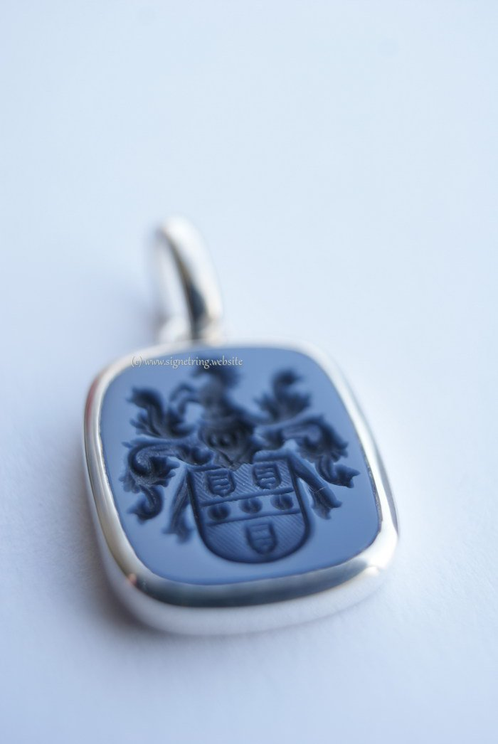 Silver hanger with coat of arms engraving
